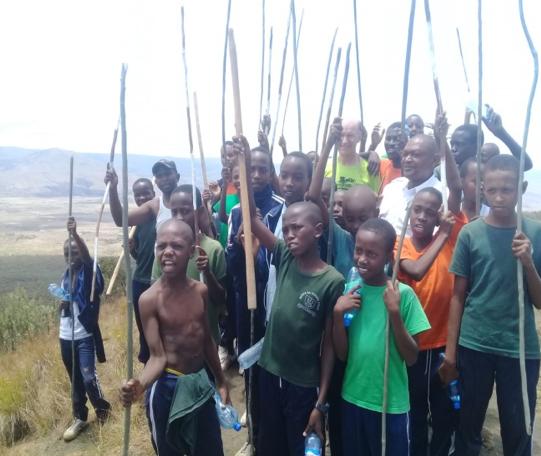 Students celebrating a successful climb