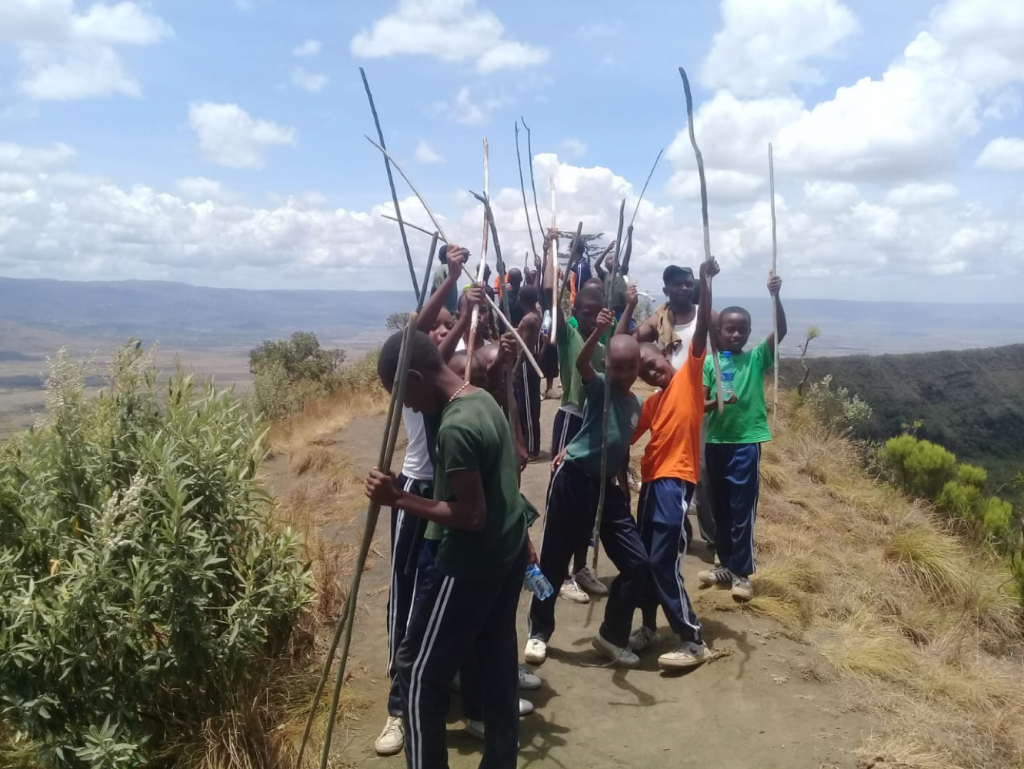 Students celebrating having walked around the crater